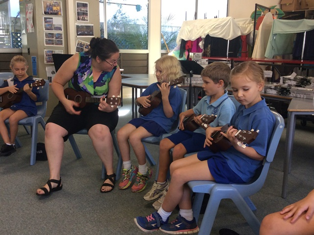 teacher and students playing ukeleles